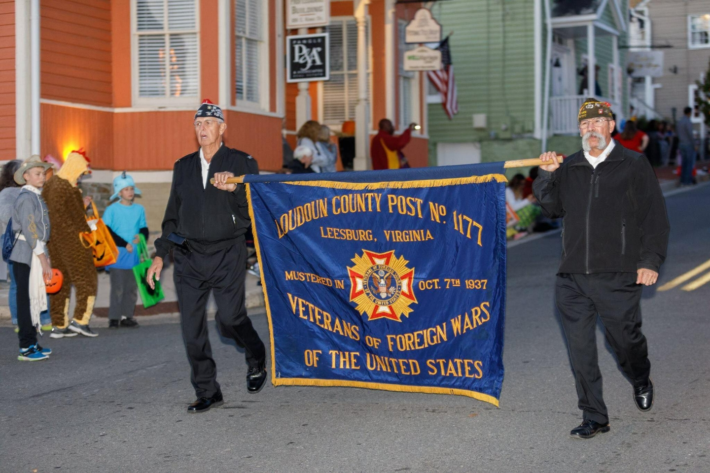 Comrades Phil Rusciolelli and Max Gutierrez lead the VFW Post 1177 contingent in the parade.  Photo Courtesy of Mark Mogle Photography - www.markmoglephoto.com