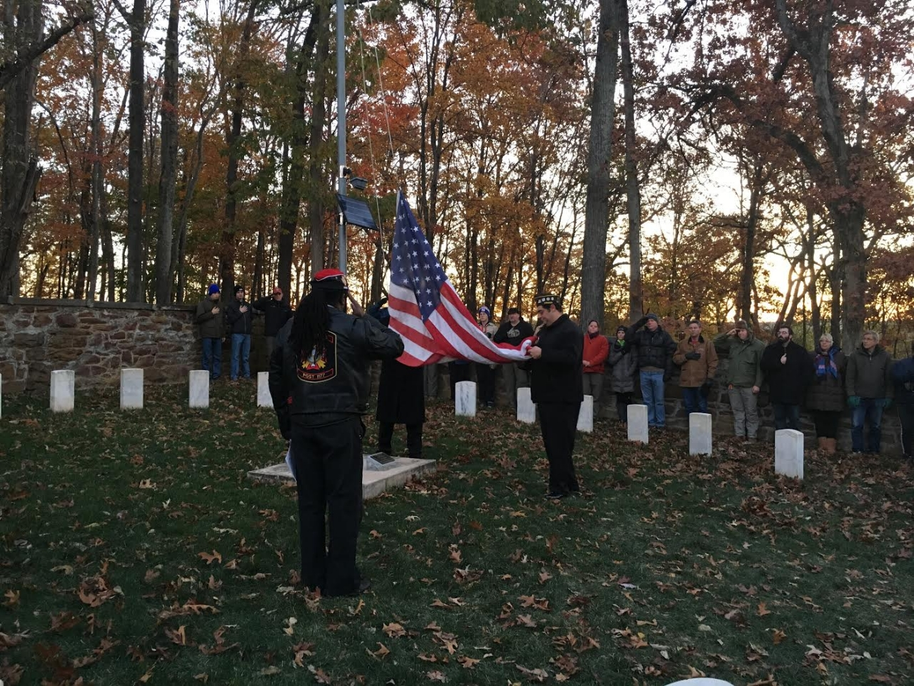 The colors are raised during the Veterans Day Sunrise Ceremony at Balls Bluff.
